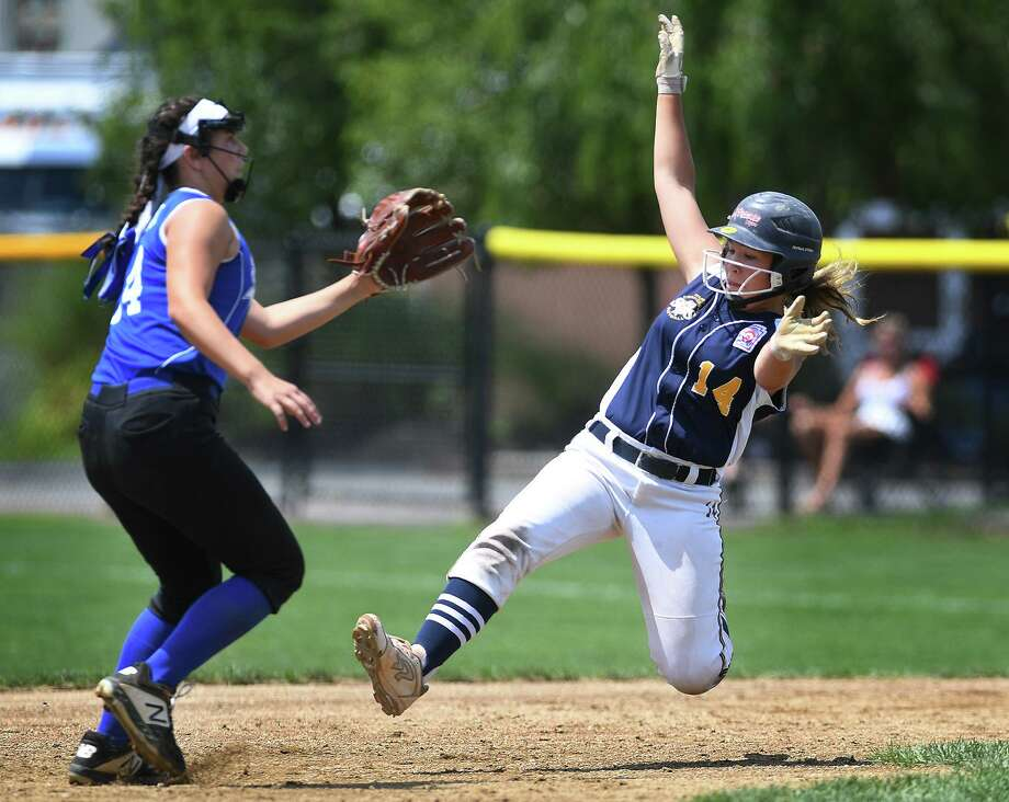 Milford's Mya Dawid slides safely into second base on her way to scoring a tying run in the 4th inning of the championship game of the 2019 Little League Softball Eastern Regional Tournament in Bristol on ThursdaySouth Williamsport, PA defeated Milford, 3-2. Photo: Brian A. Pounds / Hearst Connecticut Media / Connecticut Post