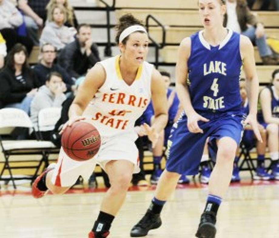TO THE HOOP: Ferris State guard Katie Mavis (left) gets to the basket during Saturday's basketball action. (Pioneer photo/Martin Slagter)
