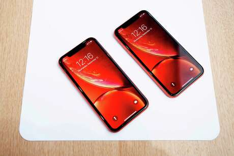 In this file photo taken on September 12, 2018 Apple iPhone Xr models rest on a table during a launch event in Cupertino, Calif.