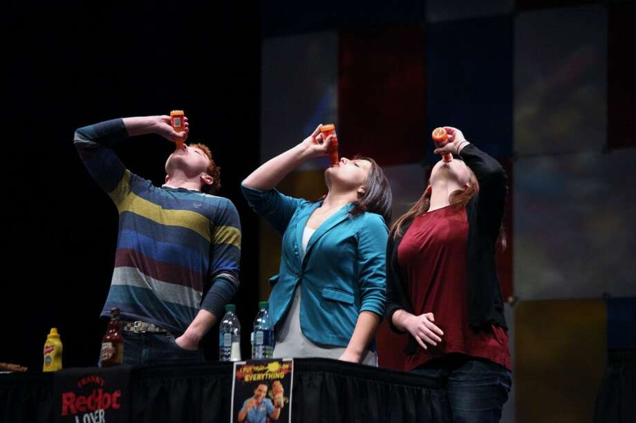 "RED HOT: Ferris students compete to see who can drink a bottle of Frank's RedHot sauce fastest. ""Food Dude"" Kevin Roberts passed out samples, T-shirts and bottles of hot sauce throughout his presentation on Thursday."