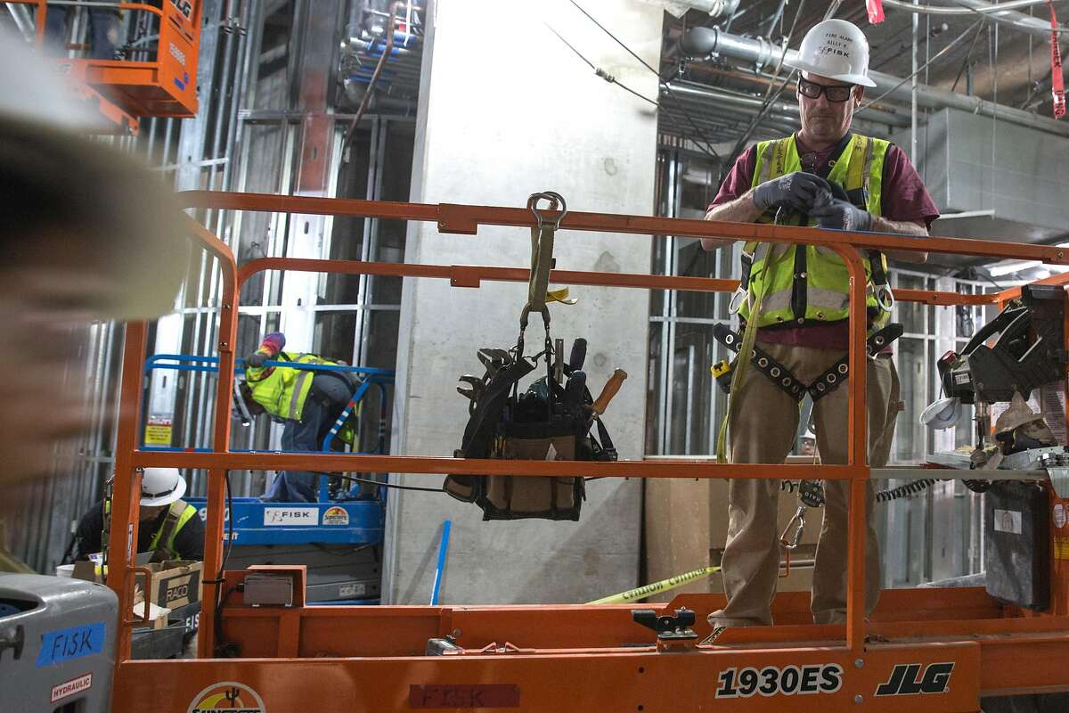 Laborers at work at the construction site of the Union Square/Market St. Central Subway Station. According to officials it will still take months of contraction work before the station officially opens. Thursday, July 25, 2019. San Francisco, Calif.