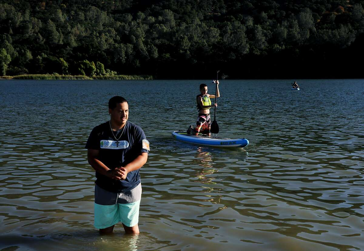 Brandon Vicente, 19, of Tracy, cools off in Lake del Valle at Del Valle Regional Park in Livermore, Calif., on Saturday, July 13, 2019. Rising temperatures are expected to make parts of the nation unlivable. A report due out Thursday by the Union of Concerned Scientists suggests that this warmer future is near. In one of the most comprehensive looks at where extreme heat will be most problematic in the U.S., and exactly when, the new study projects that cities in California's Central Valley will see weeks, if not months, of triple digit temperatures by 2050. San Francisco and other coastal cities will only see the occasional 100 degree day by mid-century, but not far inland, spots like Napa, Livermore and Morgan Hill will see triple digit weather as much as seven times more often.