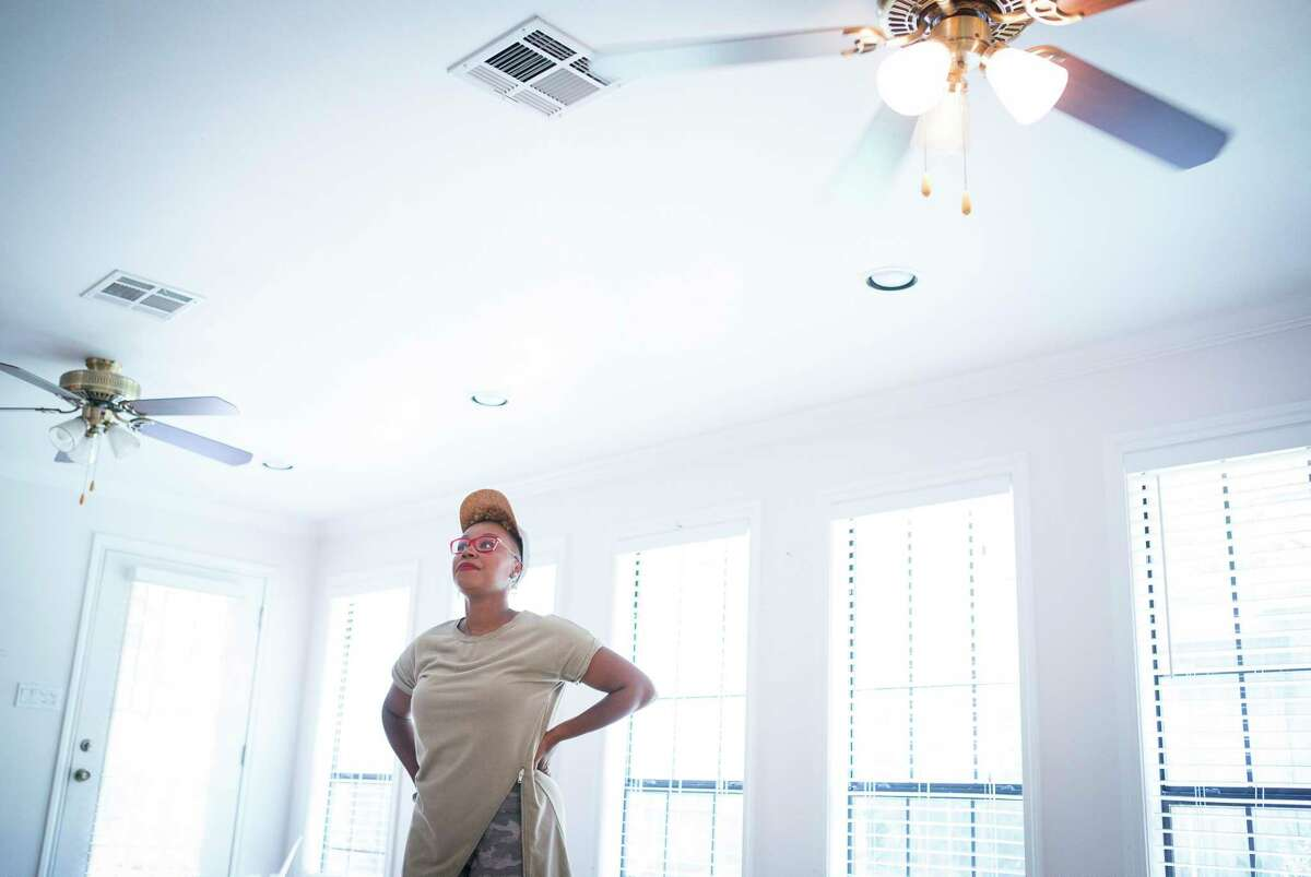 """Mary Tjon-Joe-Pin makes a plan for a new lighting design for a home she is flipping with her husband, Jon, in the Oak Forest neighborhood, Tuesday, July 9, 2019. The couple have a new show called """"Going for Sold"""" debuting in August on HGTV about flipping Houston real estate."""