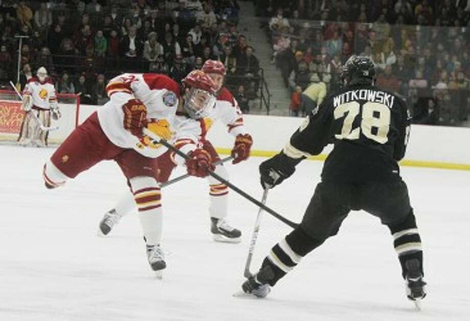 LAST SERIES: Ferris State's Justin Buzzeo (left) and the Bulldogs travel to Ann Arbor to take on Michigan in the Central Collegiate Hockey Association regular season finale. (Pioneer file photo)
