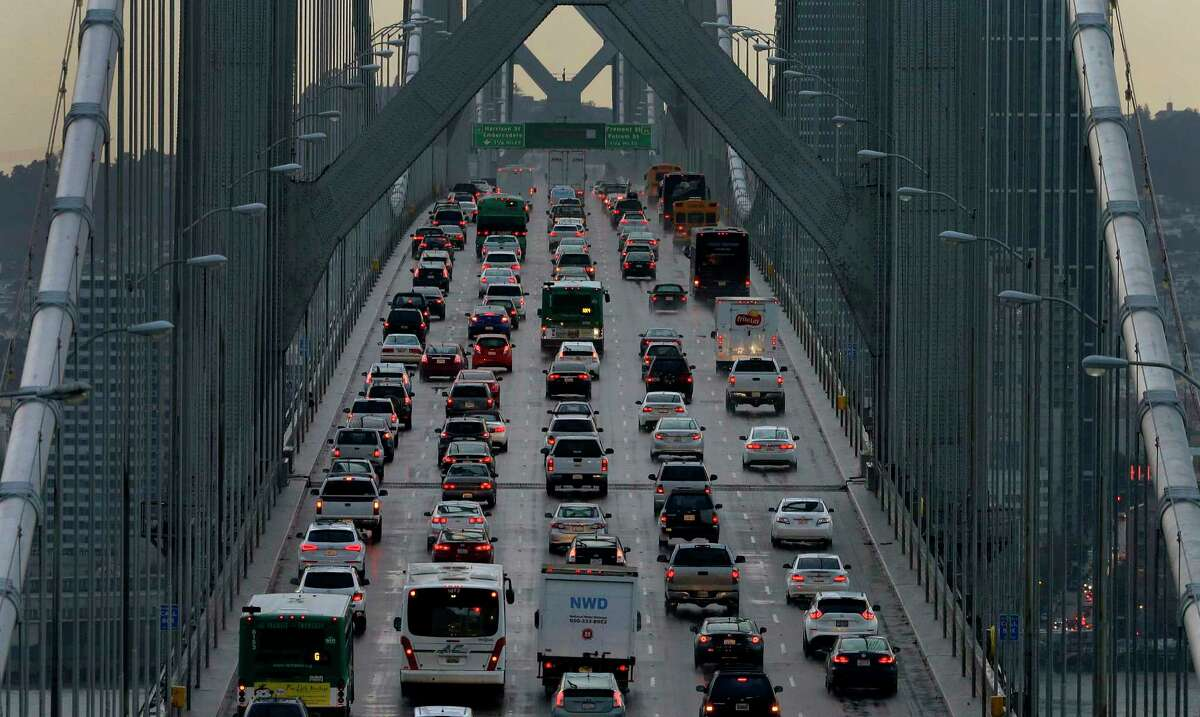 FILE - In this Dec. 10, 2015, file photo, vehicles make their way westbound on Interstate 80 across the San Francisco-Oakland Bay Bridge as seen from Treasure Island in San Francisco. Four major automakers have reached a secret deal with California to increase gas mileage and greenhouse gas emissions standards, bypassing the Trump administrationa€™s plan to freeze standards at 2021 levels, according to two people briefed on the matter. (AP Photo/Ben Margot, File)