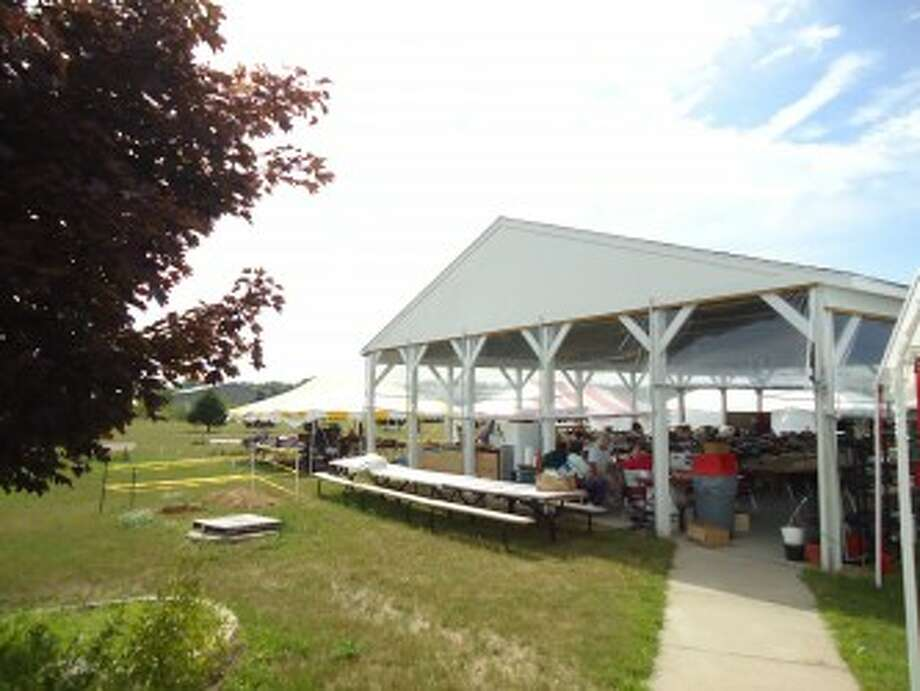 GEARING UP: Recently, volunteers at the Mecosta County Senior Center have been setting up the pavilion and several other tents on the grounds for the center's annual yard sale, and largest fundraiser, which opens on Saturday. Nothing at the sale is priced, instead the center asks customers to offer a fair donation which will directly benefit the center and its activities. (Courtesy photo)