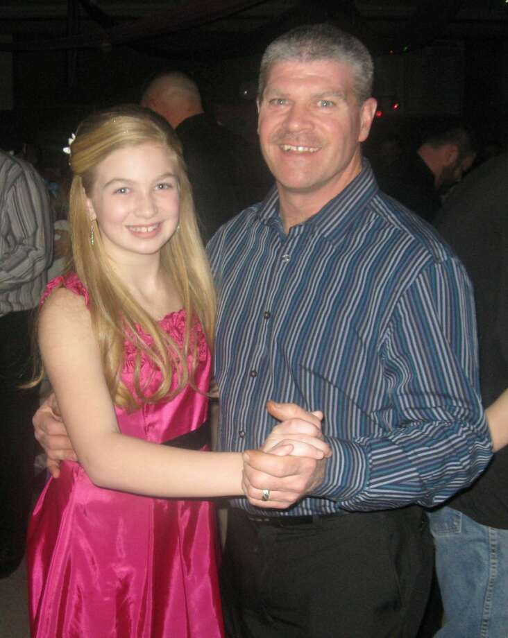 DANCING THE NIGHT AWAY: Morley Stanwood Elementary School held its first Daddy-Daughter Dance on Feb. 9. More than 180 people attended the dance, which was funded by the student council. (Courtesy photos)