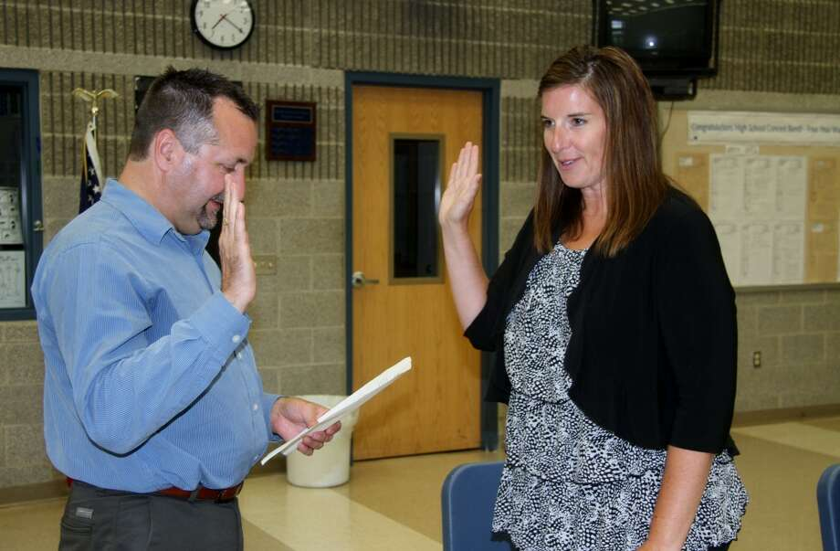 WELCOME A-BOARD: Morley Stanwood Community Schools Superintendent Roger Cole swears in Lisa Brauher as a board of education member. Brauher was appointed to the board on Thursday. (Pioneer photo/Lauren Fitch)