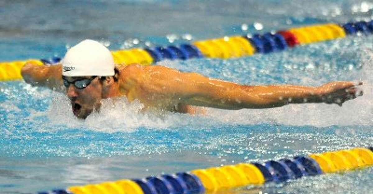 SEARCHING FOR GOLD: Swimmer Michael Phelps competes in the men's 200 meter butterfly event at the Charlotte UltraSwim Grand Prix in May. Phelps has won 16 medals in two consecutive Summer Games, including a record eight gold medals in the 2008 Beijing Games. (MCT photos)