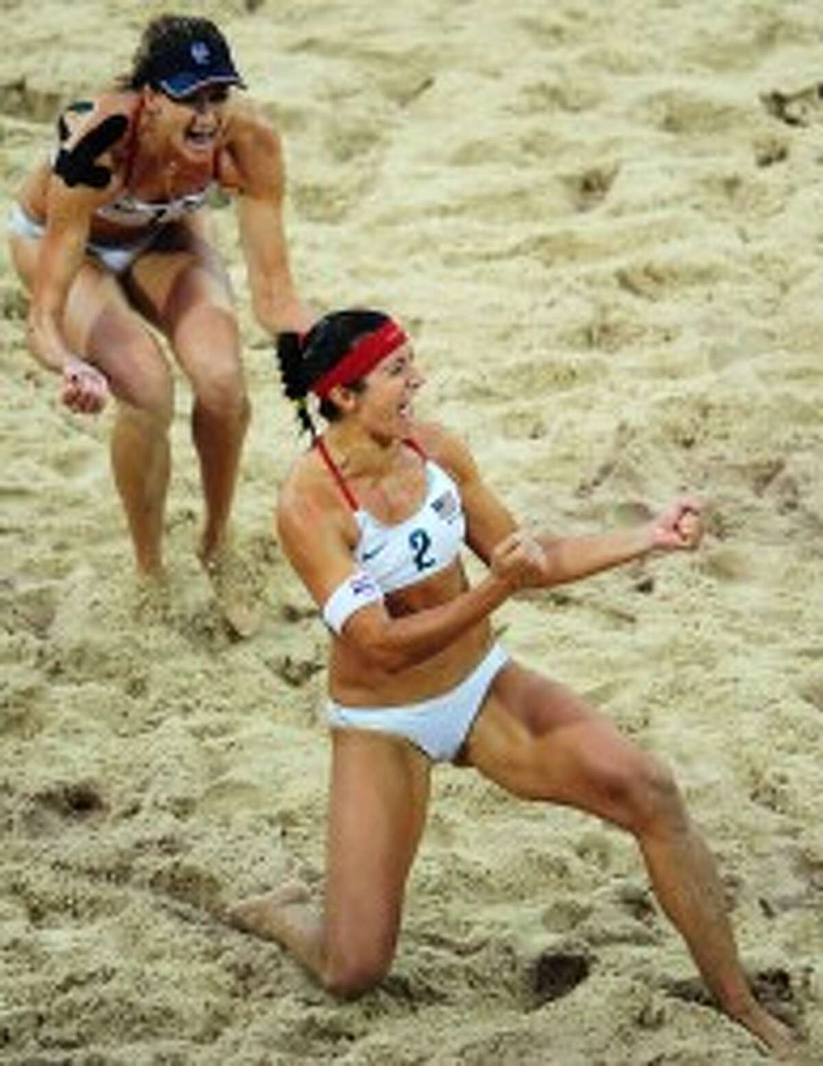 SPIKERS: Kerri Walsh, left, and Misty May-Treanor, right, celebrate after winning the women's beach volleyball gold medal match at the 2008 Beijing Summer Games. It was the pair's second Olympic gold medal in the event.
