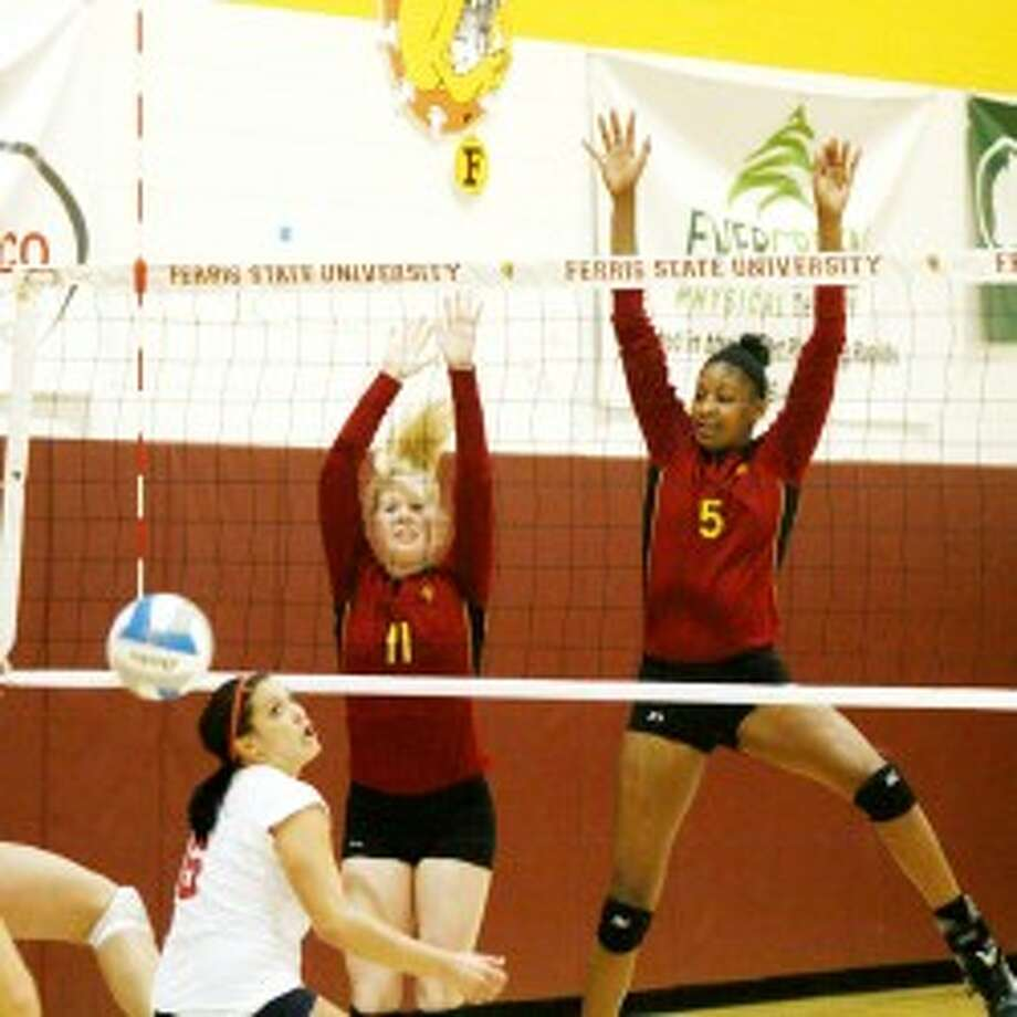 "HANDS UP: Former Ferris State volleyball player Arielle Goodson (5) goes up for a block during her career at FSU. Goodson was one of 10 former Bulldogs named to the most recent addition of the program's ""Top 40 Players of the First 40 Years."" (Pioneer file photo)"