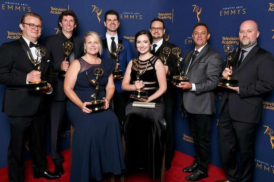 """(From left, back) Jordan Wilby, Craig Henighan, Bradley North, David Werntz, Zane Bruce, Antony Zeller, (front) Tiffany Griffith and Lindsay Pepper made up the sound effects team that won an Emmy for Outstanding Sound Editing for a Comedy or Drama Series for the eighth episode of season two of the Netflix original series, """"Stranger Things."""" (Courtesy photo)"""