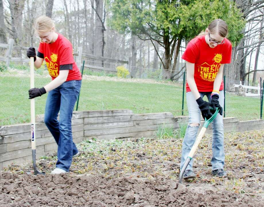 COMMUNITY SERVICE: Ferris State University students participate in the 2012 Big Event. This year's community service project will be held on April 13, and the deadline for homeowners to register is March 22.
