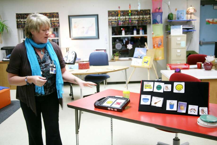 EDUCATION INTEGRATION: A teacher at the Mecosta-Osceola Intermediate School District's Education Center explains different learning tools her special education students use. Area educators are discussing options for integrating high school students with emotional impairment and autism into general education classes at their home districts. (Pioneer file photo)