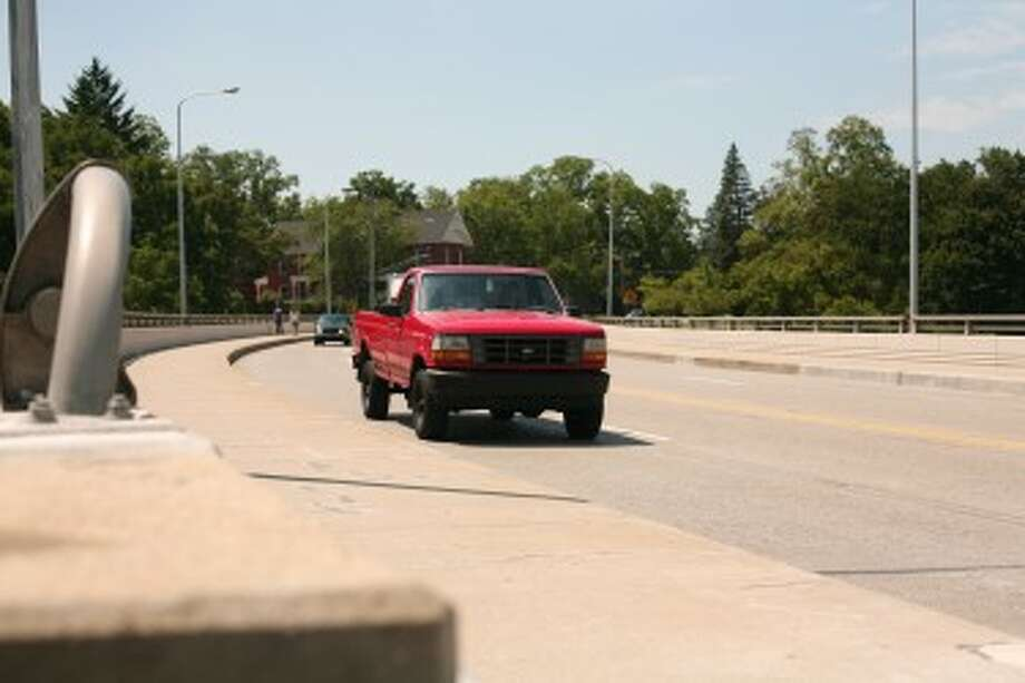 BRIDGE PROJECT: A more than $480,000 project to rehabilitate the Maple Street Bridge will continue on Aug. 13. The Muskegon River crossing will close Aug. 17 through 20 while construction workers apply a weatherproofing epoxy coating. (Pioneer photo/Jonathan Eppley)