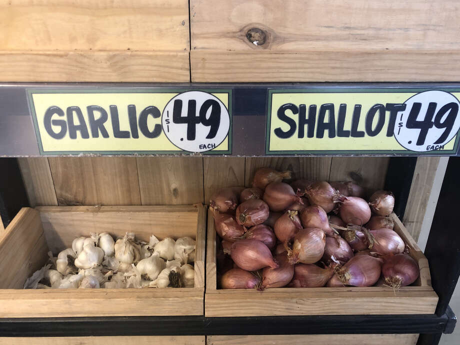 At this local Trader Joe's in San Francisco, the grocery chain had already implemented some of these packaging changes. Check out these loose heads of garlic sans their usual sleeves. Photo: Nikki Tran / SFGate