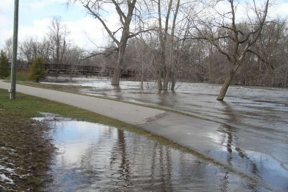 NO PARKING: A large area of Hemlock Park flooded Tuesday as waters in the Muskegon River rose above the banks. (Pioneer photo/Whitney Gronski-Buffa)