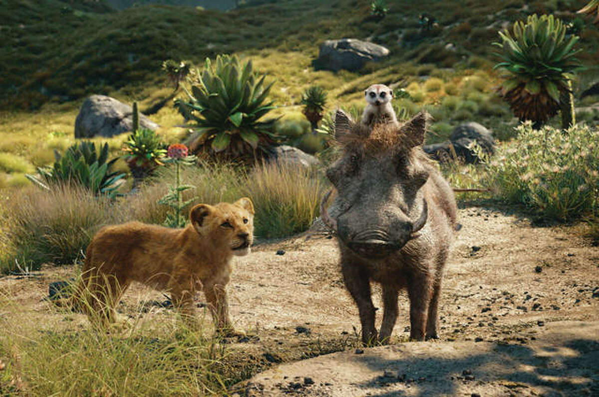"""From left, young Simba, voiced by JD McCrary; Timon, voiced by Billy Eichner; and, Pumbaa, voiced by Seth Rogen, in a scene from """"The Lion King."""" The Walt Disney Co. ruled the box office again with the record-breaking debut of """"The Lion King."""" The studio stated that the photorealistic remake set a record in ticket sales for North America for the month of July, PG-rated films and the ninth highest opening of all time."""