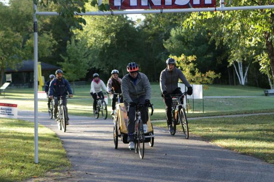 Riders take off from the starting point during the seventh annual Angel Ride-Run-Walk. Participants left from Northend Riverside Park on Saturday and returned to the park to complete the ride. (Pioneer photo/Meghan Gunther-Haas)