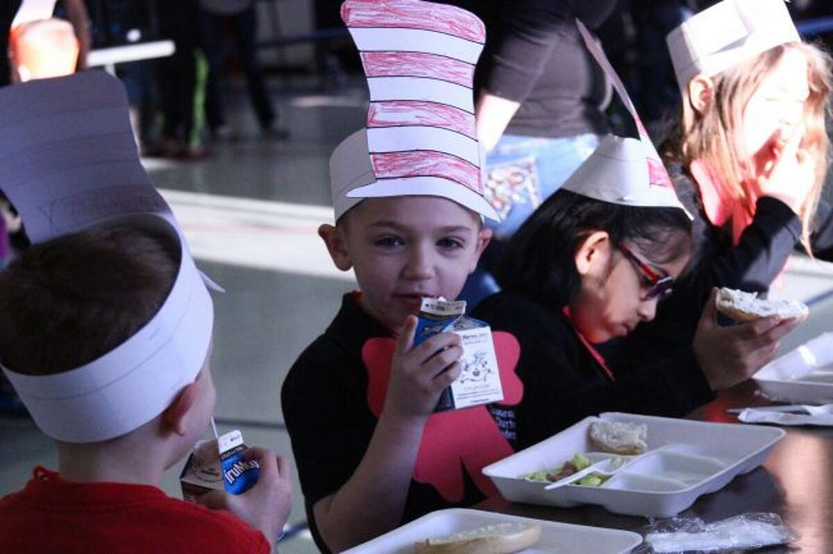 GREEN EGGS AND HAM: Jace Decker sits with his classmates to eat his green eggs and ham. The breakfast was part of the students' celebration of Dr. Seuss' birthday. (Pioneer photos/Meghan Haas)