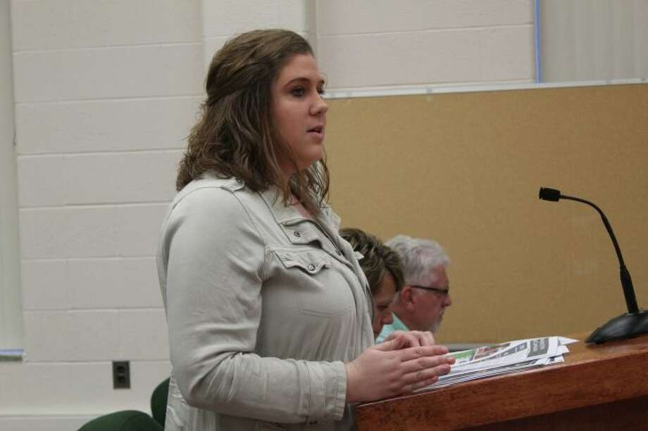 Tarin Minkel, Mecosta County's 4-H coordinator, talks about the increased efforts to share 4-H programs with children in the county who normally wouldn't have the opportunity to participate during Thursday's Mecosta County Board of Commissioners meeting. Michigan State University Extension staff provided officials with its annual report at the meeting. (Pioneer photo/Brandon Fountain)