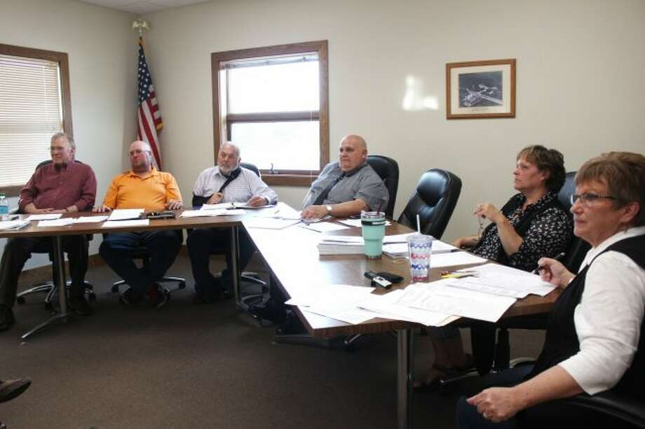 Members of the Big Rapids Township Board of Trustees listen to a presentation during Tuesday's meeting. Officials approved a point-based compensation policy for the township fire department. (Pioneer photo/Brandon Fountain)