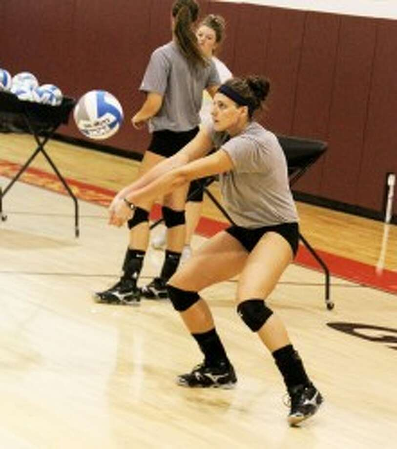 CONCENTRATION: Ferris State senior outside hitter Aly Brecht passes the ball during drills Wednesday. (Pioneer photo/Martin Slagter)