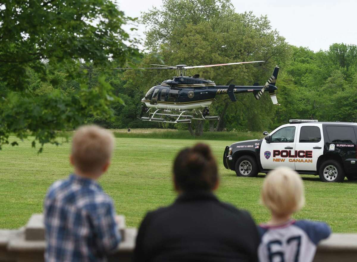 A New York State Police helicopter aids in the search for missing person Jennifer Dulos at Waveny Park in New Canaan, Conn. Wednesday, May 29, 2019. Dulos was reported missing Friday evening and police searched the area surrounding her neighborhood on Tuesday and the woods of Waveny Park on Wednesday.
