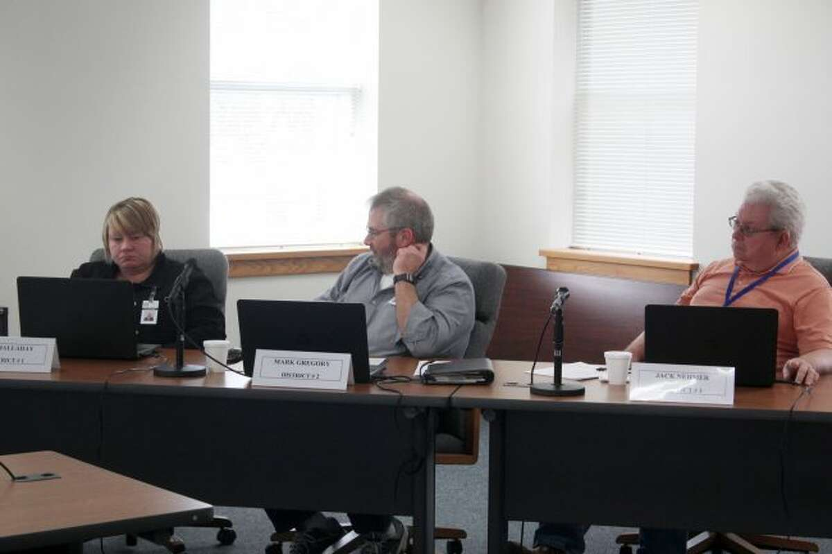 (From left) Osceola County Commissioners Jill Halladay, Mark Gregory and Jack Nehmer listen to discussion during the Committee of the Whole meeting on Tuesday at the courthouse. During the meeting, commissioners appointed Dr. Joyce deJong as the county's medical examiner. (Pioneer photo/Brandon Fountain)