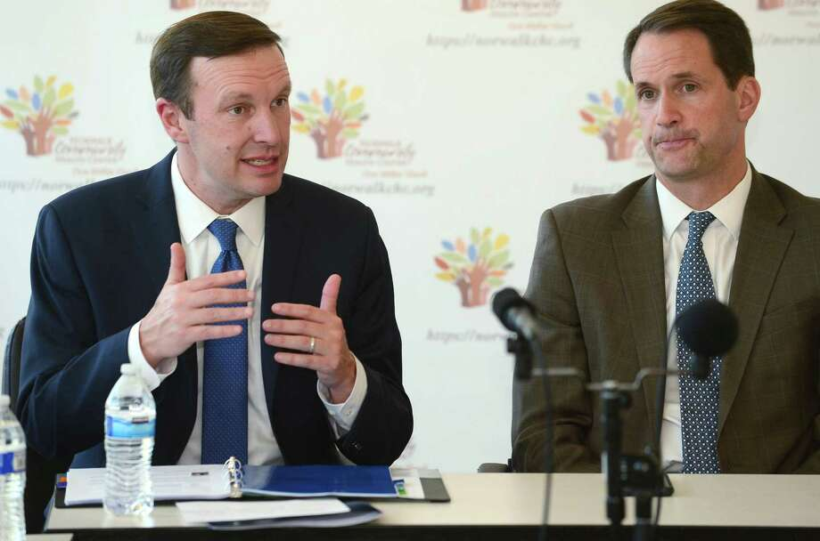 Senator Chris Murphy, left, at a health care roundtable on June 6. Photo: Erik Trautmann / Hearst Connecticut Media / Norwalk Hour