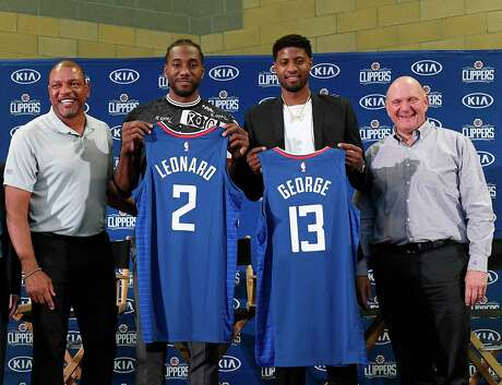 LOS ANGELES, CA - JULY 24: (L-R) Head coach Doc Rivers, Paul George, Kawhi Leonard and owner Steve Ballmer of the Los Angeles Clippers attend the Paul George and Kawhi Leonard introductory press conference at Green Meadows Recreation Center on July 24, 2019 in Los Angeles, California. NOTE TO USER: User expressly acknowledges and agrees that, by downloading and or using this photograph, User is consenting to the terms and conditions of the Getty Images License Agreement.