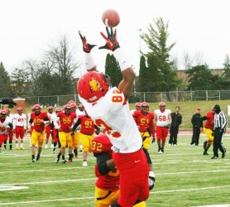 GRAB IT: Ferris State's Shakur Sanders (82) goes up to make a catch during Saturday's Crimson & Gold spring game. (Pioneer photo/Martin Slagter)