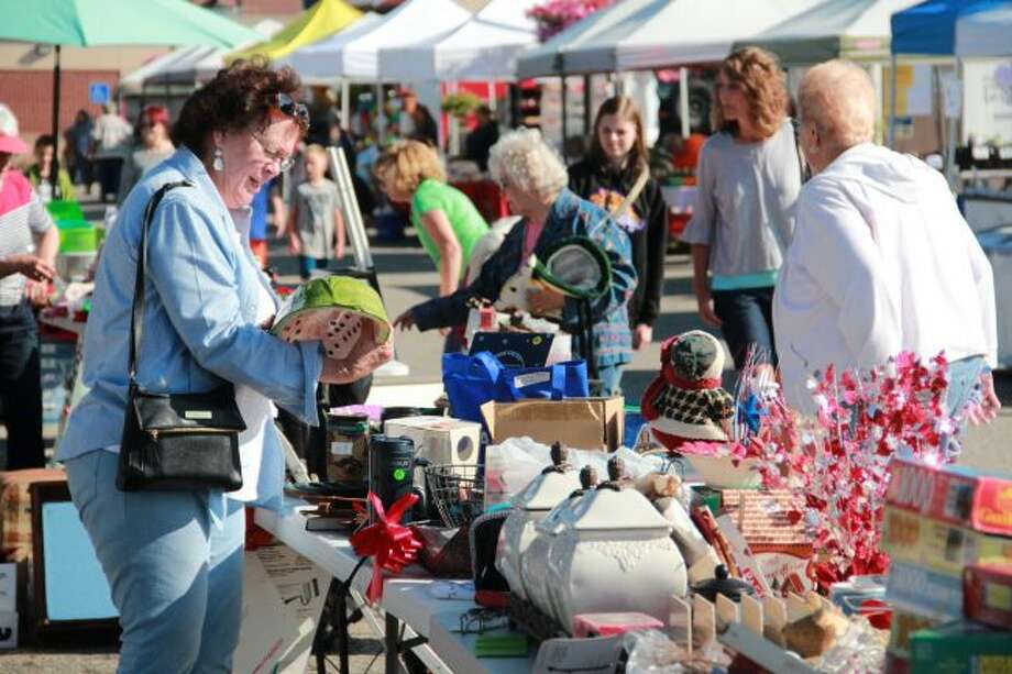 Bargain shoppers had the opportunity to find what their home was missing at the 14th annual Big Rapids All-City Yard Sale. Proceeds from the booths benefited the programming and events at Artworks. (Pioneer photo/Alicia Jaimes)