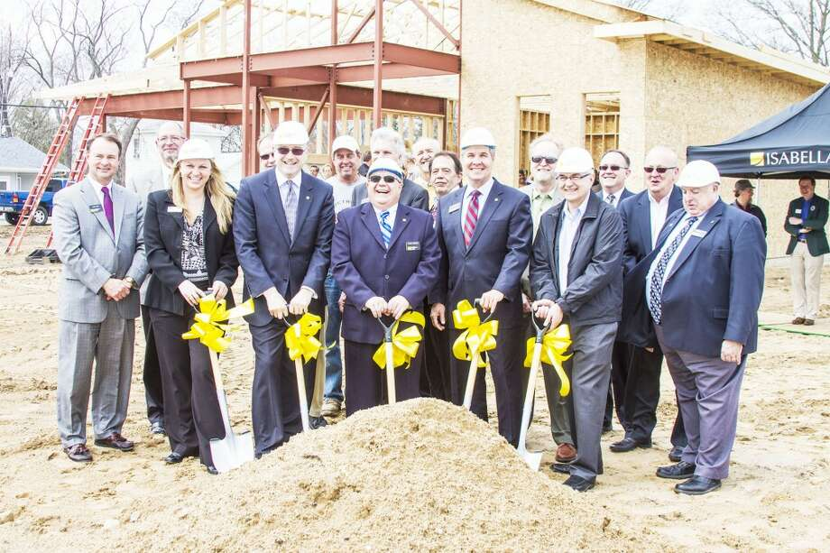 WORK IN PROGRESS: (Above) Isabella Bank employees and representatives from other community groups gather for the ceremonial groundbreaking of a new Isabella Bank site.