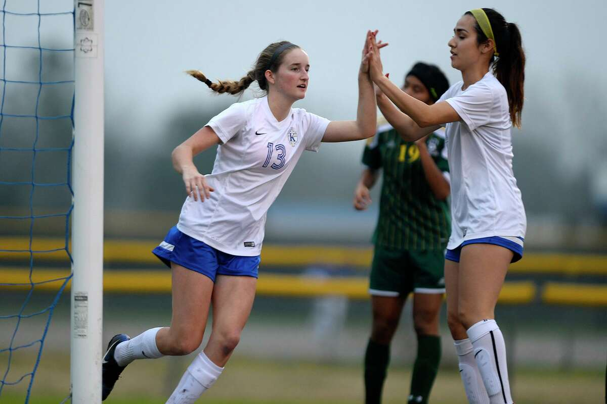 Kelly's Julia Phelan celebrates a goal with teammate Paloma Martinez against Awty International in a girls soccer game on Tuesday. Photo taken Tuesday 2/6/18 Ryan Pelham/The Enterprise