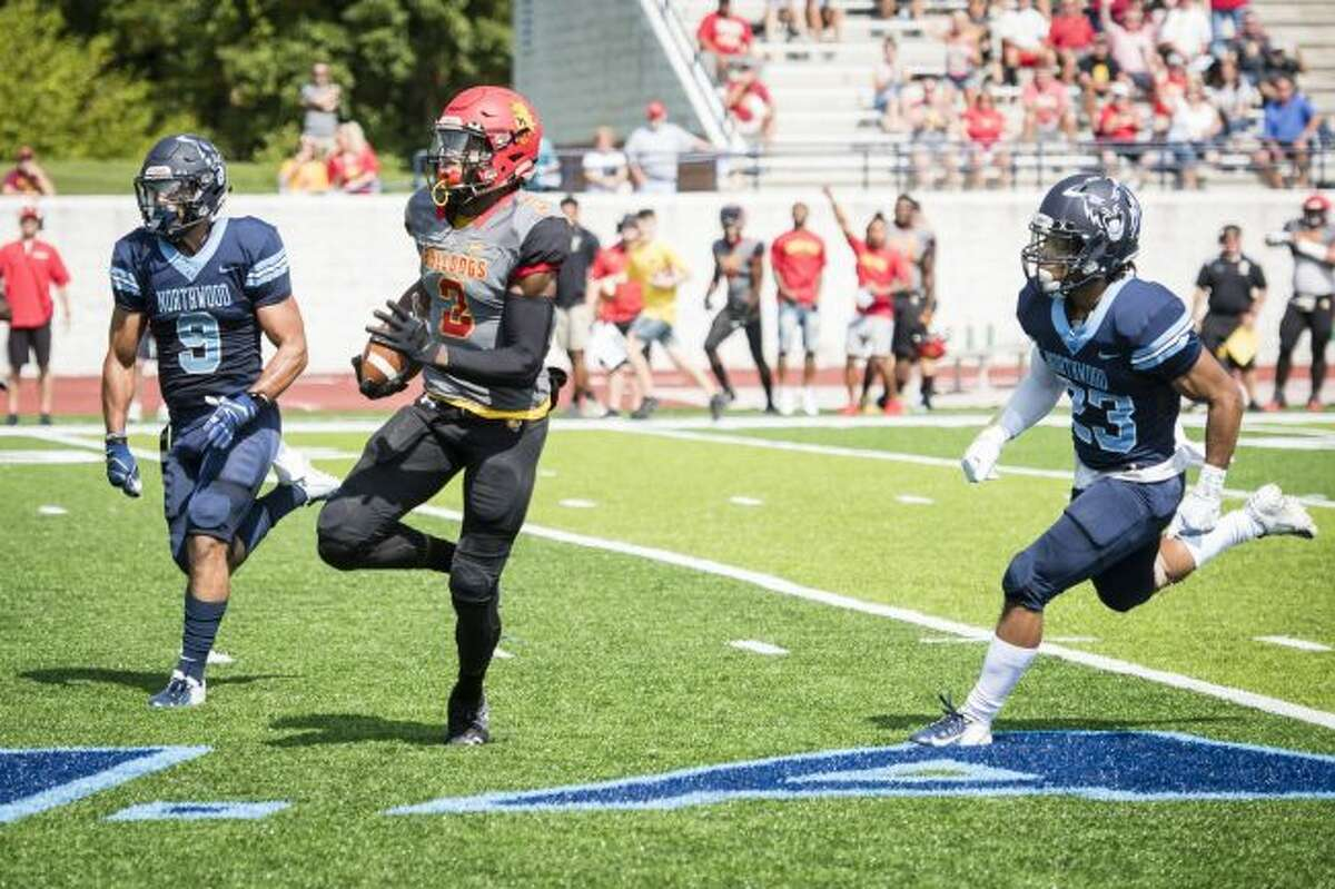 Northwood defenders Dimitri Abro and Christian Pinkney pursue Ferris State wide receiver Keyondre Craig during a game against Ferris State on Saturday at Northwood University in Midland. (Danielle McGrew Tenbusch/for the Daily News)