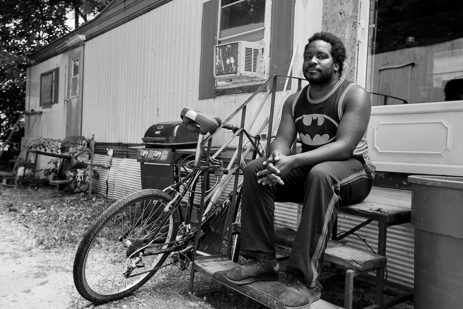 Isaac Langford, who says he didn't want to leave S.F. and that the bus ride back to Iowa ended with him being homeless again, sits on the stoop of the trailer he now calls home in Des Moines. Photo: Rachel Mummey / Special To The Chronicle