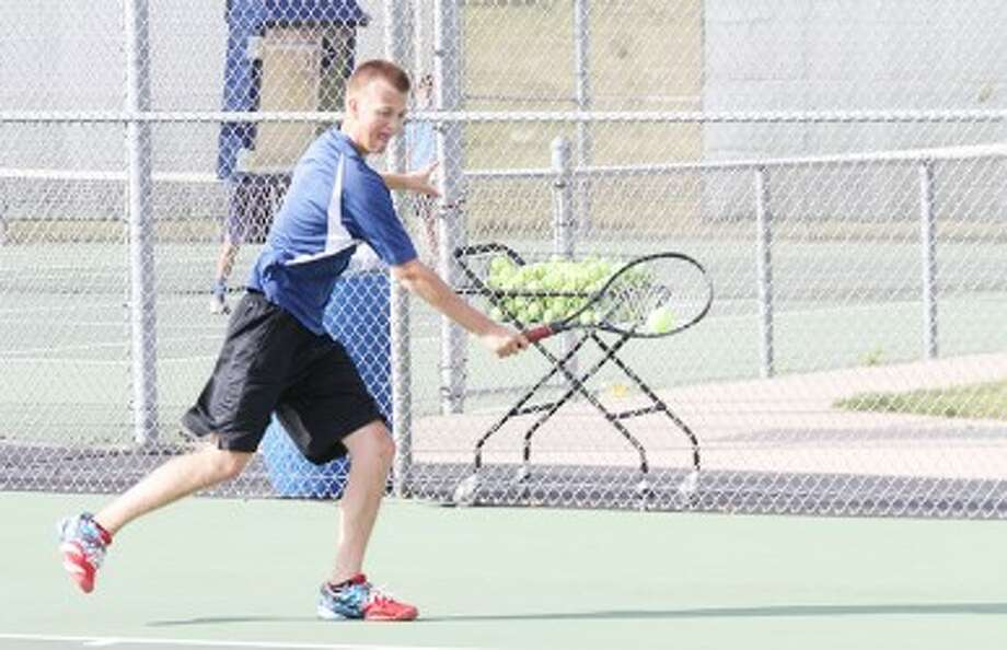 RUNNING IT DOWN: Big Rapids' Sterling Brinker goes after a shot during Thursday's tennis match against Sparta. (Pioneer photo/Bob Allan)
