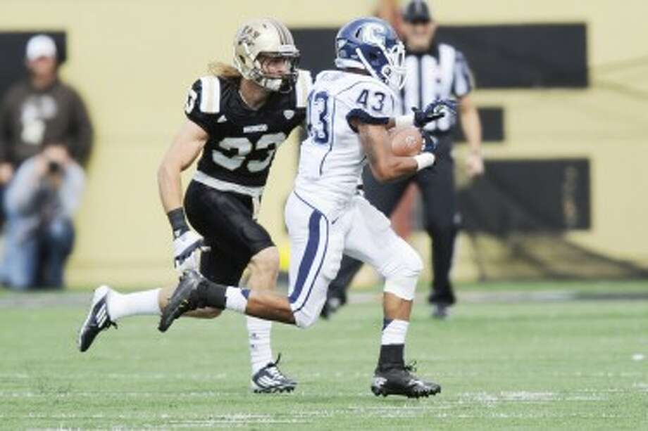 MAKING THE PLAY: Former Big Rapids standout and Western Michigan safety Justin Currie makes a tackle. (Courtesy photo/Western MIchigan University)