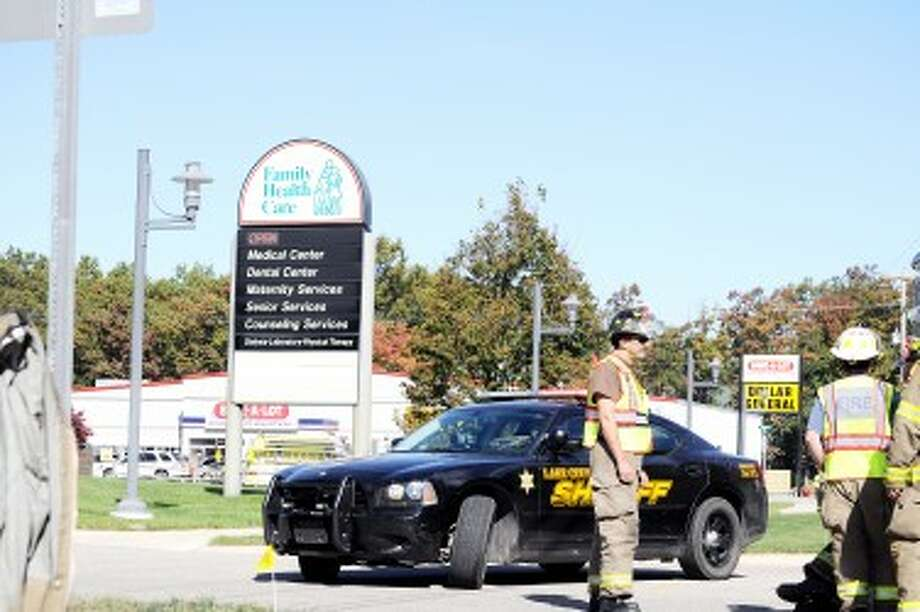 Lake County Sheriff's Office, Baldwin Fire Department and Webber Township Fire Department officials responded to a report of a bomb threat at Baldwin Family Health Care on Tuesday. (Pioneer photo/Kyle Leppek)