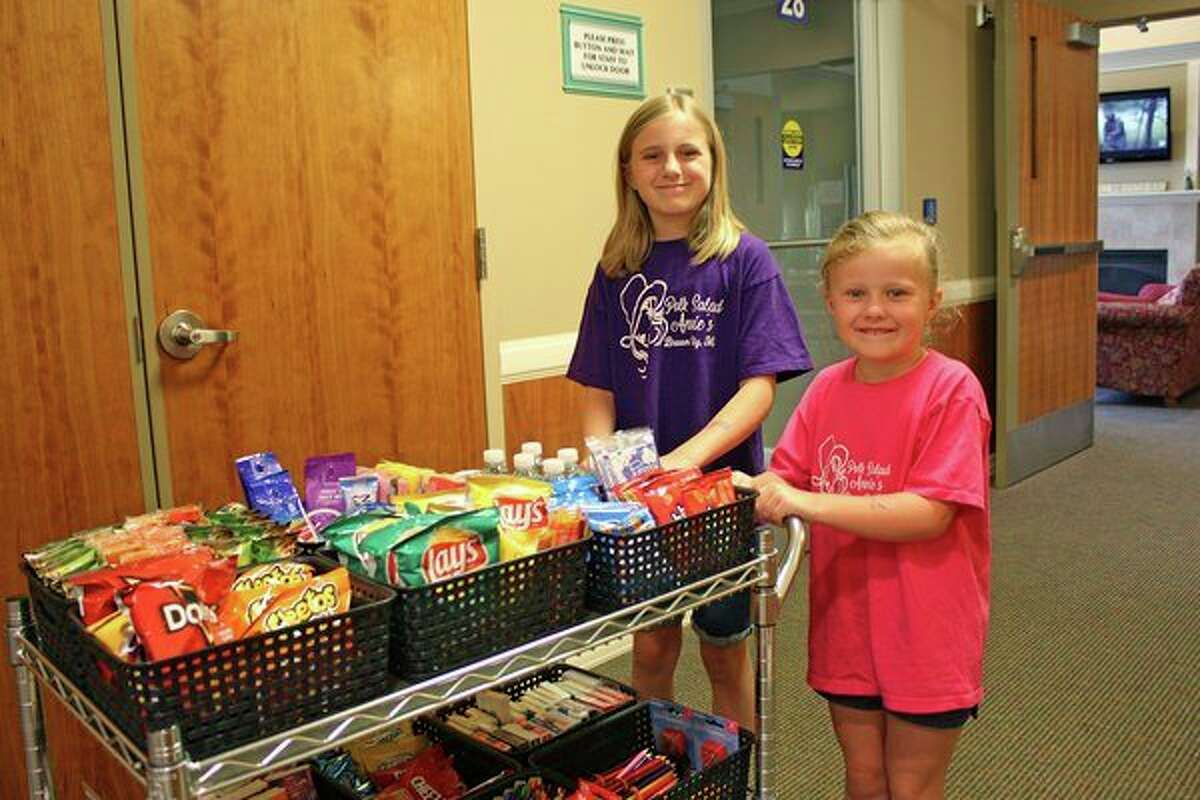 A new feature at the United Hospice Residence in Marlette is a hospitality cart furnished by local contributors, both young and old. Among the first contributors were Peyton and Emerson Lindke of Croswell. The pair wanted to help local people in need this summer, so they teamed up with their grandmother, Gloria Abel of Marlette, to collect items such as snacks, drinks, games, puzzles and books for patients and visiting family members at the Hospice Residence in Marlette. The girls have even furnished a colorful donation box that is housed at Polk Salad Annie's in Brown City to help collect goods throughout the year. (Submitted Photo)