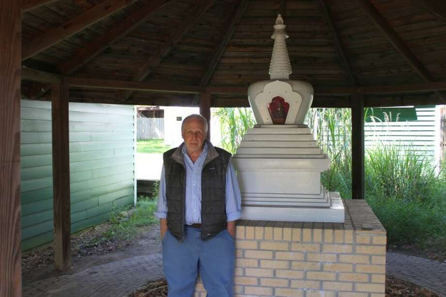 STUPA: Michael Erlewine poses next to his Stupa, a Buddhist religious monument. (Pioneer photo/Devin Anderson)