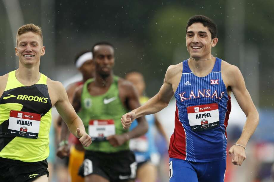 Bryce Hoppel beats Brannon Kidder, left, to the finish line in a preliminary heat in the men's 800-meter run at the U.S. Championships athletics meet, Thursday, July 25, 2019, in Des Moines, Iowa. (AP Photo/Charlie Neibergall) Photo: Charlie Neibergall/Associated Press