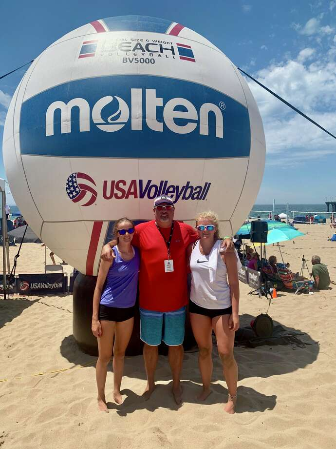 Avery Fowler, coach James Barker and Emily Hillman pose after Fowler and Hillman competed in the 18U division of the USA National Beach Tour Junior Championships in Manhattan Beach, Calif. Photo: Courtesy Photo