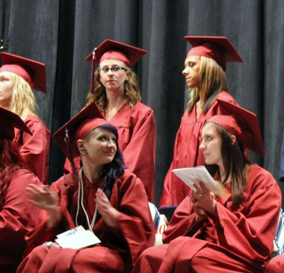 CLASS OF 2013: Mosaic School graduates applaud during their graduation ceremony on Wednesday evening. Mosaic is the alternative high school for Chippewa Hills School District. (Pioneer photos/Lauren Fitch)
