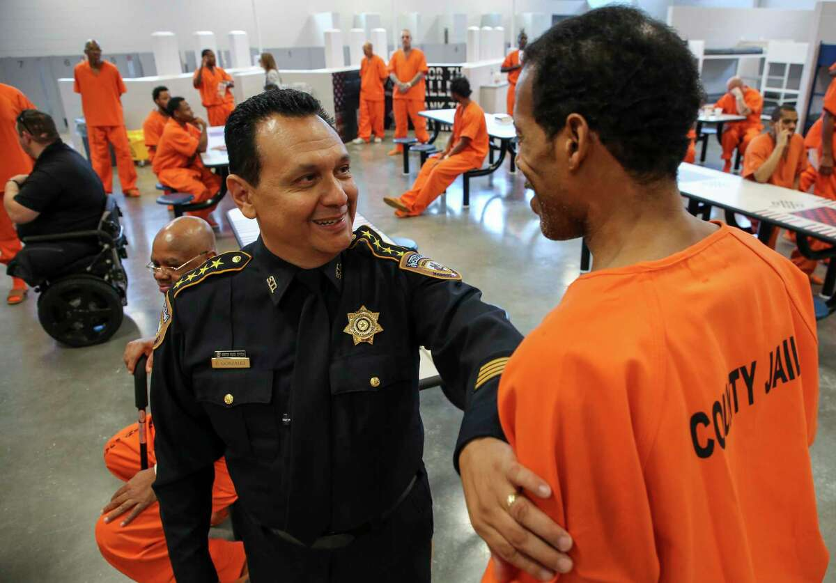Harris County Sheriff Ed Gonzalez talks with Navy veteran Kenneth Martin, 55, inside the Harris County Joint Processing Center Thursday, July 25, 2019, in Houston. These inmates have been identified as U.S. armed force veterans and have been placed in the Brothers in Arms program. Through this program, veterans in the jail will be able to live together and receive veteran-targeted resources and services.