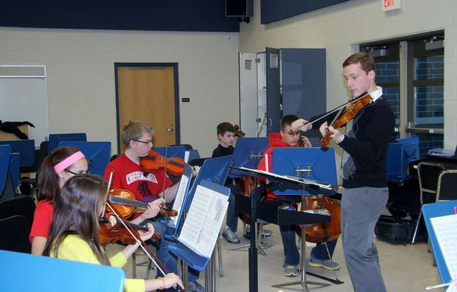 NO ENCORE: Central Michigan University student Ben Gudbrandson led the Chippewa Hills School District orchestra as an after-school club this school year. On Monday, the board of education rejected a proposal to re-instate the program as part of the district's curriculum, which would have cost at least $30,000 from CHSD's general fund. (Pioneer file photo)