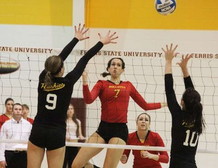 VERTICAL: Ferris State's Anne Sutton hits a shot over the net against Michigan Tech in the Bulldogs' 3-0 win on Friday. (Pioneer photo/Martin Slagter)