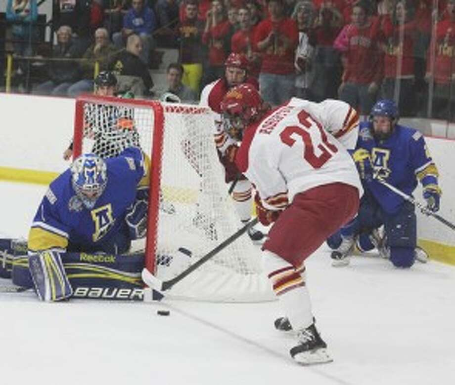 CLOSE ENCOUNTER: Ferris State's Matt Robertson puts a shot on net on Friday against Alaska. (Pioneer photo/Martin Slagter)