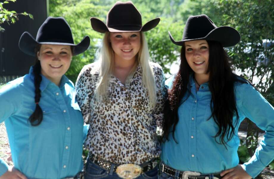 RODEO FINALISTS: (From left to right) Breann Nelson, Saige Nabozny and Brenda Nelson, all 17, have earned spots at the National High School Finals Rodeo in July. The girls, from Big Rapids and Evart, will travel to Wyoming to compete in a variety of riding and roping events. (Pioneer photo/Lauren Fitch)